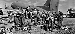 11th Airborne Division (United States) - Paratroopers of the 511th Parachute Infantry Regiment prepare for their combat jump on Tagaytay Ridge, 3 February 1945.