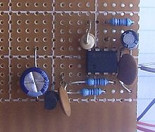 A 555 timer circuit on perforated board
