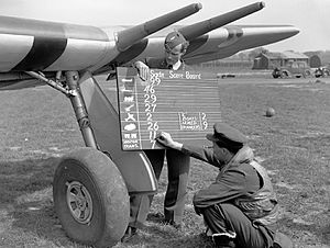No. 56 Squadron RAF -  Flt Lt Erik Haabjoern Norway holds the unit scoreboard, his right hand obscures the squadron number.