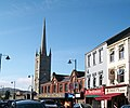 A Row of Shops and the Spire of St Mary's CofI Church, John Mitchel's Place, Newry - geograph.org.uk - 1561753.jpg