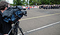 A Scottish journalist films the U.S. Naval Forces Europe Band as it rehearses its show segment in the Royal Edinburgh Military Tattoo 120801-N-VT117-2056.jpg