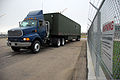 A flatbed truck carrying self-contained mobile satellite communications equipment exits a gate at Greely Air National Guard Station, Colo., June 8, 2009 090608-F-BR512-019.jpg