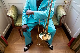 A member of the Orquesta Buena Vista Social Club waiting in the Green Room of the White House.jpg