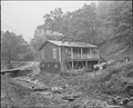 A miner's house by the dirty stream which is used for garbage and trash disposal. Raven Red Ash Coal Company, No. 2... - NARA - 541068.tif