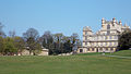 A view of Wollaton Hall west front and Stable Block from the south-west, Nottingham, England.jpg