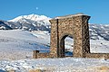 A winter scene at Roosevelt Arch with a setting moon (32269046157).jpg