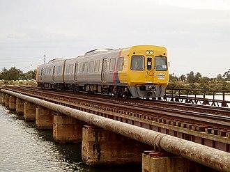 Outer Harbor railway line - 3000 class railcar travelling along the Port River bridge