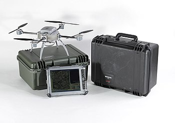 English: Aeryon Scout UAV system with its cont...