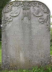 Photographie en couleur d'une pierre tombale en grès