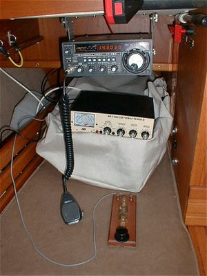 Maritime mobile amateur radio - An amateur radio installation on a 28' yacht including 100W HF transceiver with microphone, manual antenna tuner and morse key