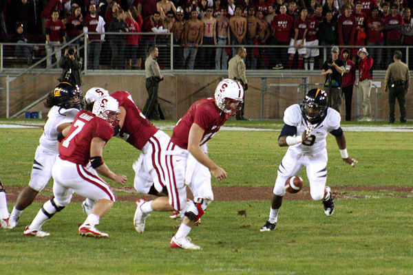 Stanford quarterback Andrew Luck fumbles the snap against California on the way to a 34-28 loss in the 2009 Big Game. Andrew Luck fumbles at 2009 Big Game.jpg