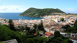 Historic city center of Angra do Heroísmo, with the cinder cone Monte Brasil, as seen looking towards the south coast of Terceira