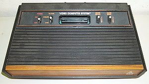 "Atari 2600 four-switch ""wood veneer"" version, while the original 2600 had six switches."