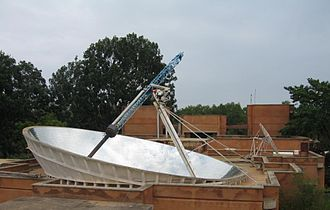 Solar energy - Parabolic dish produces steam for cooking, in Auroville, India