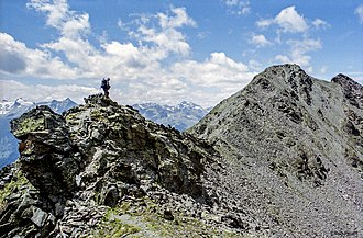 Hiking on an arete, Otztal Alps, Austria. An example of a hiking route that involves sure-footedness, and a head for heights Austria ridge hike.jpg