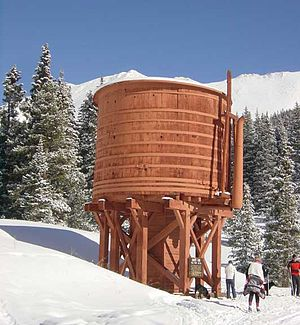 Denver, South Park and Pacific Railroad - Cross-country skiers traveling along the old railroad grade pass the restored Bakers water tank in Summit County, west of Boreas Pass