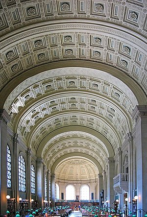 Boston Public Library, McKim Building - Bates Hall has a coffered ceiling in a wide catena-arched barrel vault. Internet and power connections are discreetly located beneath the large wooden research tables.