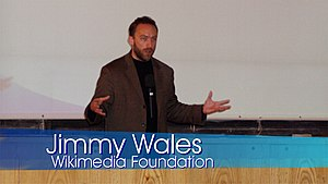 Lower third - A lower third graphic identifies the person speaking as Jimmy Wales, and as a member of the Wikimedia Foundation.