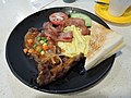 Beef steak and fried egg and bacon breakfast zooming up.jpg