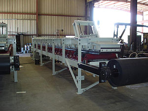 Variable rate feeder - Custom made belt feeder to be used in a material handling capacity.