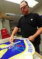 Bernard Jones, with the 509th Civil Engineer Squadron, cleans a sign displaying the U.S. Air Force Global Strike Command insignia at Whiteman Air Force Base, Mo., March 11, 2013 130311-F-EA289-285.jpg