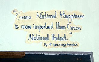 Buddhist economics - Slogan in Bhutan about gross national happiness in Thimphu's School of Traditional Arts.