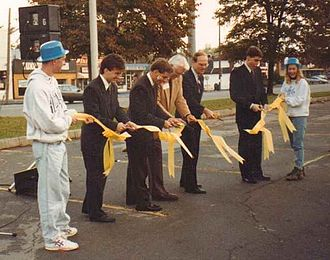 Bill Greiner - Bill Greiner (Center) with Dennis Gorski and UB Student Government Leaders Cutting Homecoming Ribbon, Buffalo, NY, October 1991