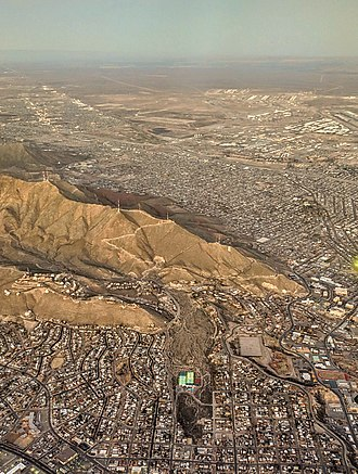 Arroyo (creek) - Aerial view of El Paso's Arroyo Park, or Billy Rogers Arroyo, providing a path for runoff of rain on the Franklin Mountains behind