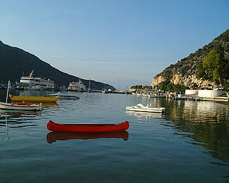 Tolo, Greece - A view of boats in the bay of Tolo, including pier.