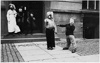 Fastelavn - Costumed children walking door to door. Denmark 1930s.