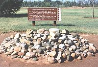 Pile of stone in front of informational sign