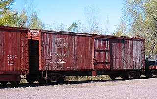 Boxcar railroad car that is enclosed and used to carry freight