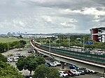 Brisbane CBD seen from Brisbane International Terminal and Airport railway line approaching International Terminal railway station, Brisbane, Queensland 01.jpg
