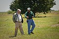 Buddy Alders, left, visits with Floyd Nauls, NRCS district conservationist, about biomethane energy production on Alders' farm. (24816509410).jpg