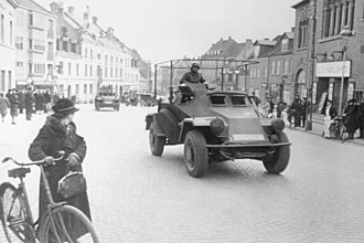 Norwegian Campaign - German armoured cars moving through a Danish town