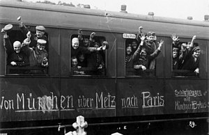 Mobilization - German soldiers in a railway car on the way to the front in August 1914. The message on the car reads Von München über Metz nach Paris. (From Munich via Metz to Paris).