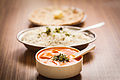Butter Paneer Tomato Curry with Rice and Chapati with spoons.jpg