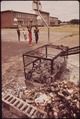 CORNER OF THIS BIRMINGHAM SCHOOL PLAYGROUND DOUBLES AS DUMP-INCINERATOR - NARA - 545490.tif