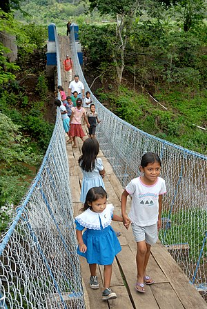 Bridges to Prosperity - Children crossing a new footbridge built with Bridges to Prosperity in El Salvador.