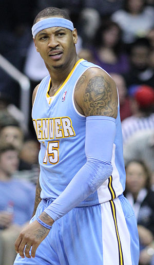 Basketball uniform - Carmelo Anthony wearing a modern-day NBA uniform, headband and arm bands as accessories