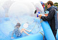 Children enjoy 'zorbing' at youth center 120702-F-EJ686-013.jpg