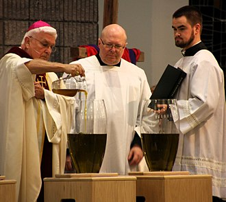 Chrism - A bishop pouring balsam into oil at Chrism Mass