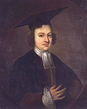 Half length and dark portrait of a serious and slightly plump man wearing a black academic gown with white collar, ruffled cuff, and a large mortarboard.