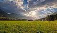 Church and meadows at sunrise in Slovenia.jpg