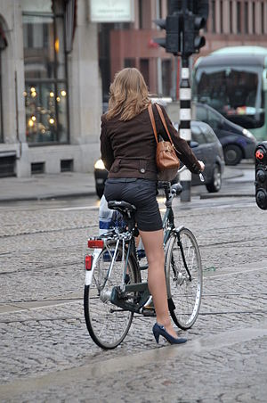 English: Beautiful girl on bike