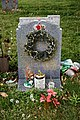 City of London Cemetery modern gravestones 2 wreath and artifacts.jpg