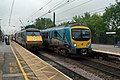 Class 91 to London King's Cross and Class 185 to Middlesbrough, pass in Northallerton station.jpg