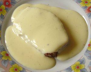 Crème anglaise - Crème anglaise over a slice of pain d'épices