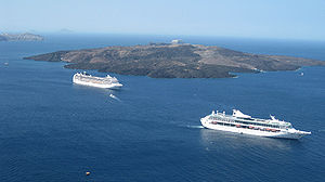 Cruise ships near the island of Santorini, Greece.