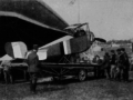 Damaged French Nieuport 10 on truck without wings 1916.png